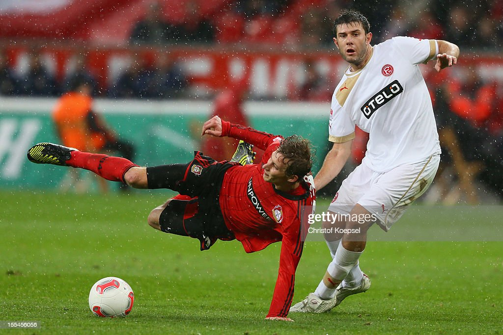 Adam Bodzek of Duesseldorf (R) challenges Stefan Kiessling of Leverkusen (L) during the Bundesliga match between Bayer 04 Leverkusen and Fortuna Duesseldorf at BayArena on November 4, 2012 in Leverkusen, Germany. (Photo by Christof Koepsel/Bongarts/Getty Images) .