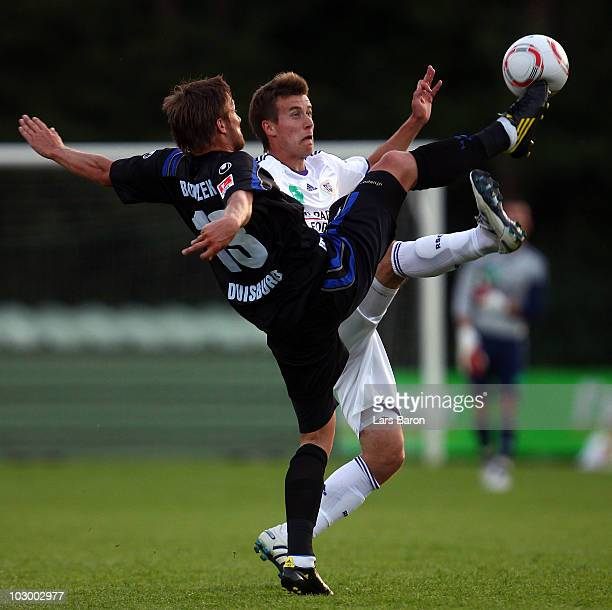 Adam Bodzek of Duisburg challenges Lukas Marecek of Anderlecht during a friendly match between RSC Anderlecht and MSV Duisburg on July 20, 2010 in...