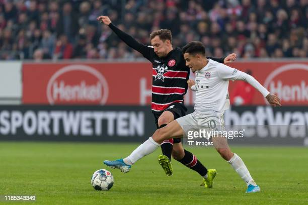 Adam Bodzek of Fortuna Duesseldorf and Philippe Coutinho of FC Bayern Muenchen battle for the ball during the Bundesliga match between Fortuna...