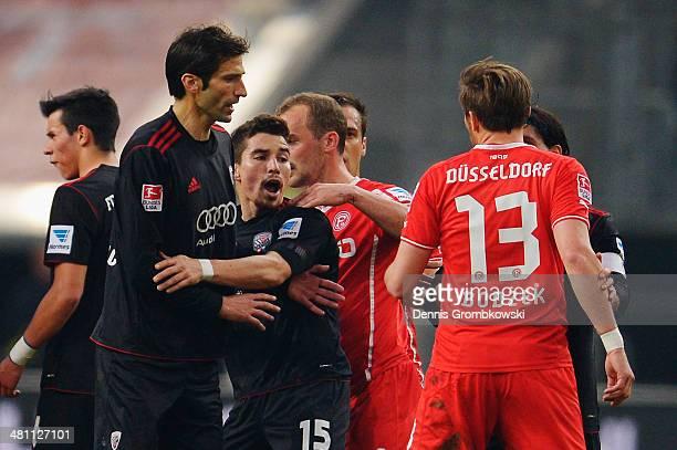 Adam Bodzek of Fortuna Duesseldorf argues with Andre Mijatovic and Danilo Soares of FC Ingolstadt during the Second Bundesliga match between Fortuna...