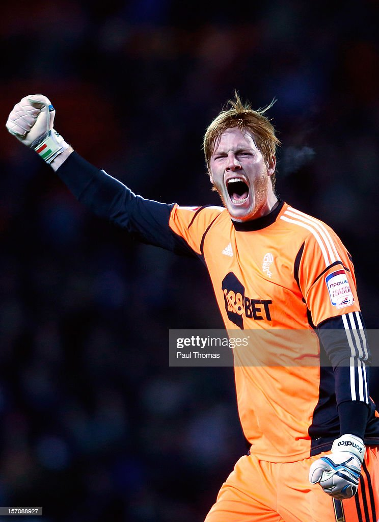 Adam Bogdan of Bolton celebrates the goal scored by team mate Kevin Davies (not pictured) during the npower Championship match between Blackburn Rovers and Bolton Wanderers at Ewood Park on November 28, 2012 in Blackburn, England.