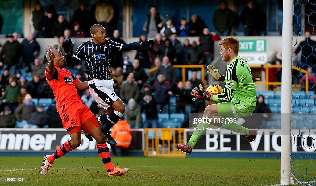 Adam Bogdan of Bolton makes a save from Simeon Jackson of Millwall during the Sky Bet Championship match between Millwall and Bolton Wanderers at The Den on February 15, 2014 in London, England.