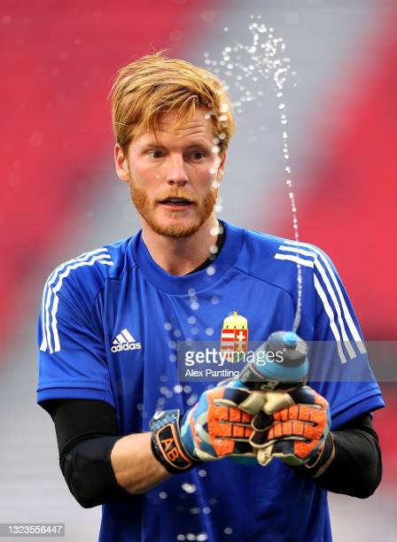 Adam Bogdan of Hungary squirts water during the Hungary Training Session ahead of the Euro 2020 Group F match between Hungary and Portugal at Puskas...