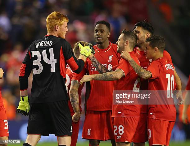 Adam Bogdan of Liverpool celebrates with team mates after saving the crucial penalty during a penalty shoot out in the Capital One Cup Third Round...