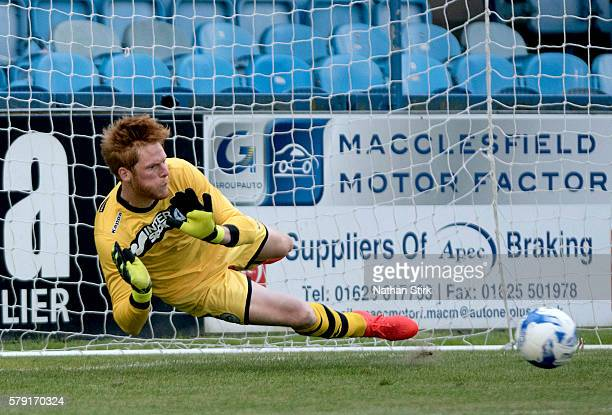 Adam Bogdan of Wigan Athletic saves a penalty during the PreSeason Friendly between Macclesfield Town and Wigan Athletic at Moss Rose Ground on July...