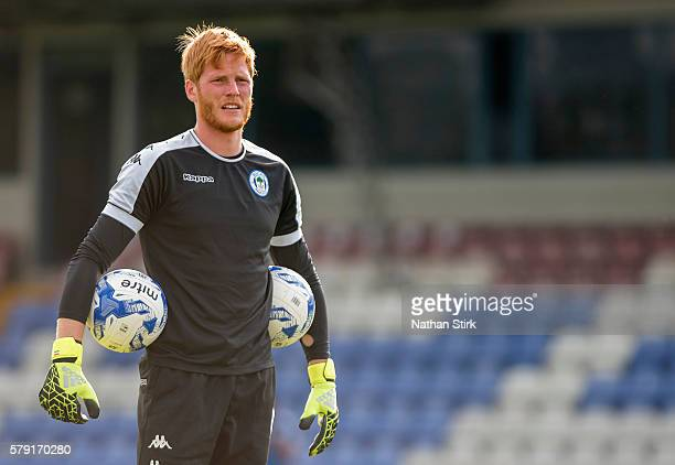 Adam Bogdan warming up prior to the PreSeason Friendly between Macclesfield Town and Wigan Athletic at Moss Rose Ground on July 20 2016 in...