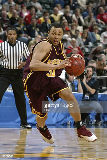 Adam Boone of the Minnesota Golden Gophers drives against the Purdue University Boilermakers during the Big Ten Tournament at the Conseco Field House...