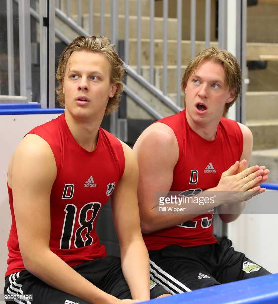 Adam Boqvist and Rasmus Sandin react as they await their turns during the NHL Scouting Combine on June 2 2018 at HarborCenter in Buffalo New York