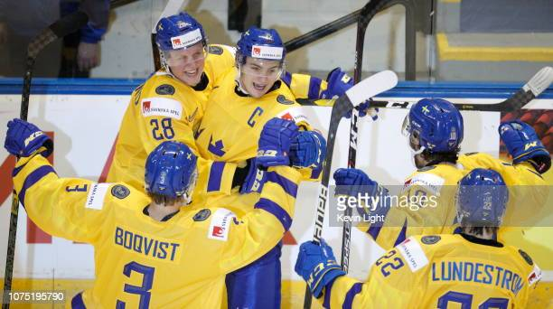 Adam Boqvist Fabian Zetterlund Erik Brannstrom Emil Bemstrom and Isac Lundestrom of Sweden celebrate a goal versus Finland at the IIHF World Junior...