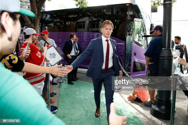 Adam Boqvist high fives fans as he arrives for the first round of the 2018 NHL Draft at American Airlines Center on June 22 2018 in Dallas Texas