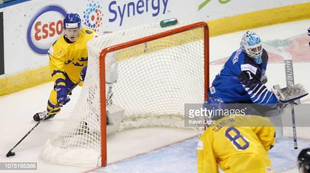 Adam Boqvist of Sweden attempts of wrap around on UkkoPekka Luukkonen of Finland at the IIHF World Junior Championships at the SaveonFoods Memorial...