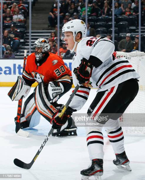 Adam Boqvist of the Chicago Blackhawks and goaltender Ryan Miller of the Anaheim Ducks look on during the second period of the game at Honda Center...