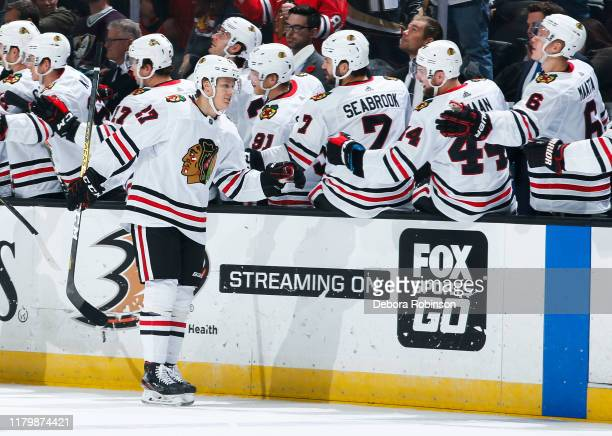 Adam Boqvist of the Chicago Blackhawks celebrates his firstperiod goal with the bench during the game against the Anaheim Ducks at Honda Center on...
