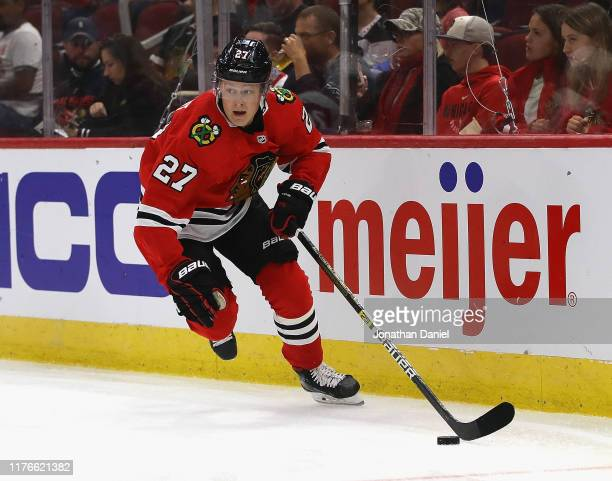 Adam Boqvist of the Chicago Blackhawks controls the puck against the Detroit Red Wings during a preseason game at the United Center on September 18...