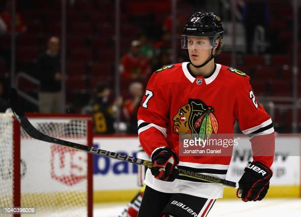 Adam Boqvist of the Chicago Blackhawks participates in warmups before a preseason game against the Detroit Red Wings at the United Center on...