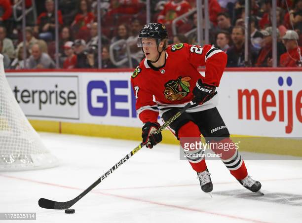 Adam Boqvist of the Chicago Blackhawks turns to attack against the Detroit Red Wings during a preseason game at the United Center on September 18...