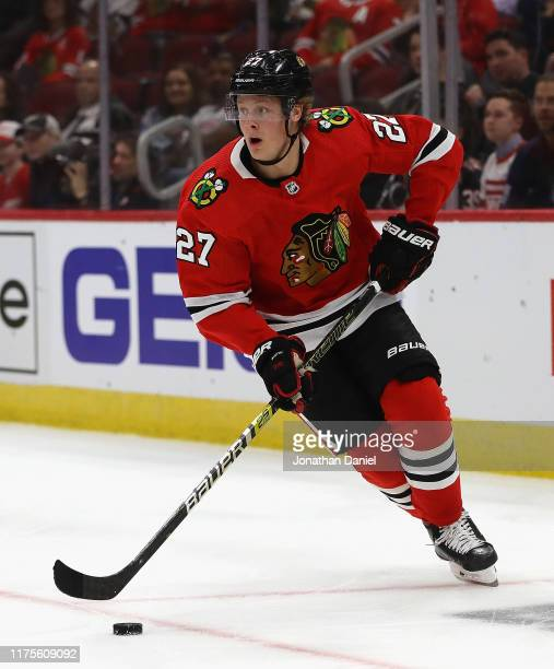 Adam Boqvist of the Chicago Blackhawks turns up the ice against the Detroit Red Wings during a preseason game at the United Center on September 18...