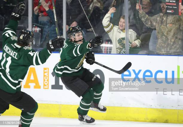 Adam Boqvist of the London Knights celebrates after scoring the gamewinning goal in overtime during OHL game action against the Flint Firebirds at...