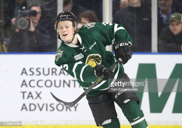 Adam Boqvist of the London Knights makes a pass in the third period during OHL game action against the Windsor Spitfires at Budweiser Gardens on...