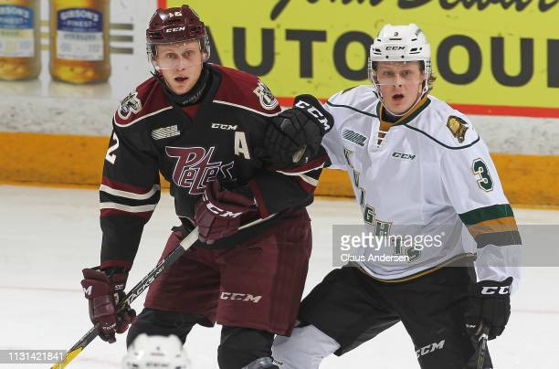 Adam Boqvist of the London Knights skates against Chris Paquette of the Peterborough Petes in an OHL game at the Peterborough Memorial Centre on...