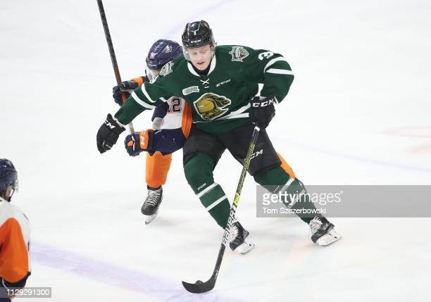 Adam Boqvist of the London Knights skates with the puck in the second period during OHL game action against the Flint Firebirds at Budweiser Gardens...