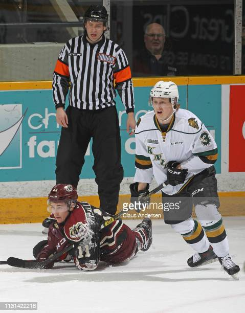 Adam Boqvist of the London Knights upends Zach Gallant of the Peterborough Petes in an OHL game at the Peterborough Memorial Centre on February 21...