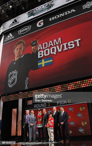 Adam Boqvist poses for a photo onstage after being selected eighth overall by the Chicago Blackhawks during the first round of the 2018 NHL Draft at...