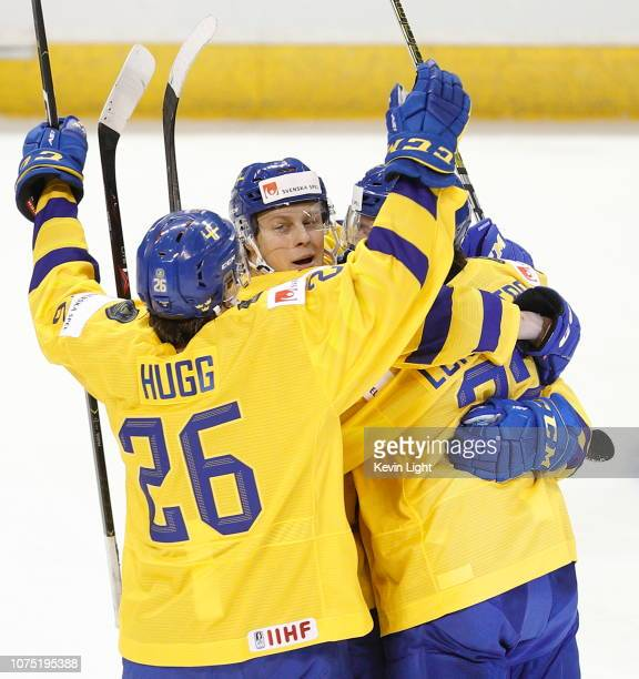 Adam Boqvist Rickard Hugg and Isac Lundestrom of Sweden celebrate a goal versus Finland at the IIHF World Junior Championships at the SaveonFoods...