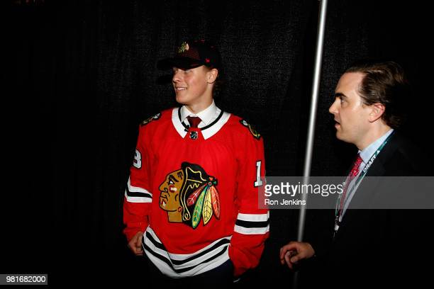 Adam Boqvist smiles after being selected eighth overall by the Chicago Blackhawks during the first round of the 2018 NHL Draft at American Airlines...