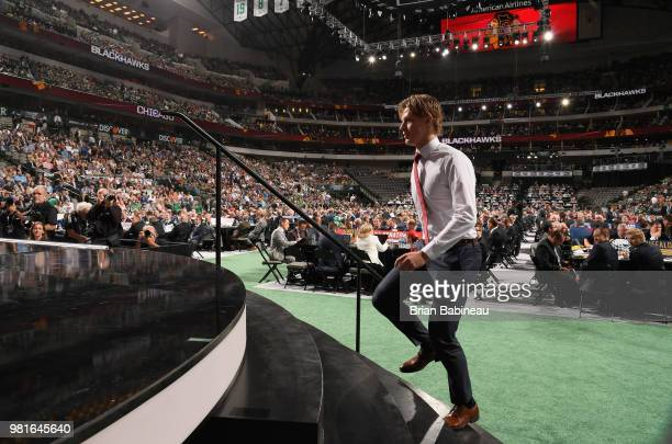 Adam Boqvist walks up to the stage after being selected eighth overall by the Chicago Blackhawks during the first round of the 2018 NHL Draft at...