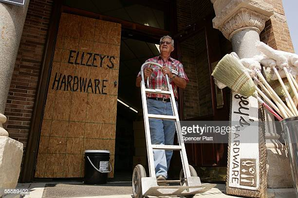 Adam Boudreaux an employee at Ellzey's Hardware walks out of the store September 15 2005 in Biloxi Mississippi The store which has been in Biolxi...