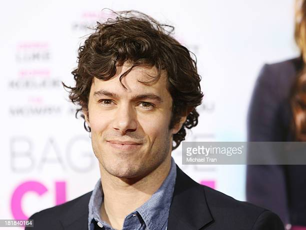 Adam Brody arrives at the Los Angeles premiere of 'Baggage Claim' held at Regal Cinemas LA Live on September 25 2013 in Los Angeles California