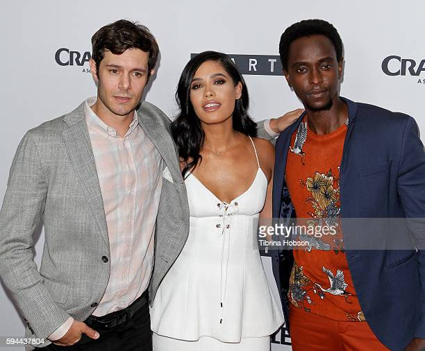 Adam Brody Otmara Marrero and Edi Gathegi attend the premiere of Crackle's 'Startup' at The London Hotel on August 23 2016 in West Hollywood...