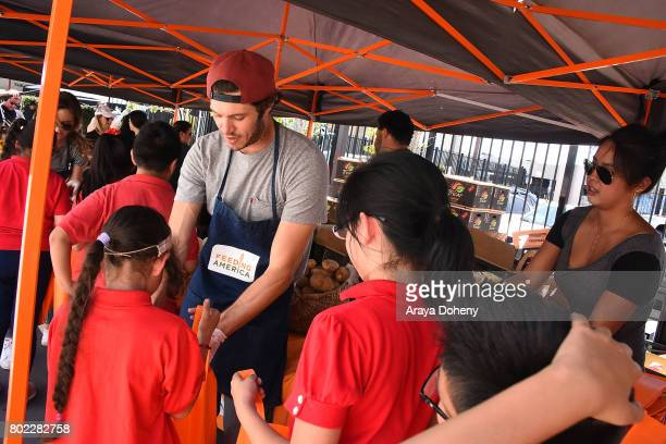 Adam Brody volunteers at Feeding America's Summer Hunger Awareness event At Para Los Ninos in Los Angeles on June 27 2017 in Los Angeles California
