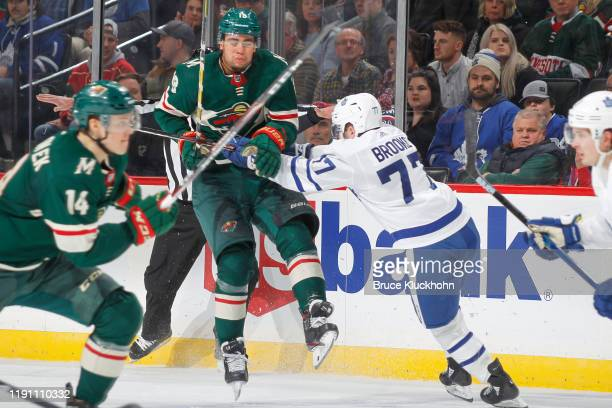 Adam Brooks of the Toronto Maple Leafs checks Jordan Greenway of the Minnesota Wild during the game at the Xcel Energy Center on December 31, 2019 in...