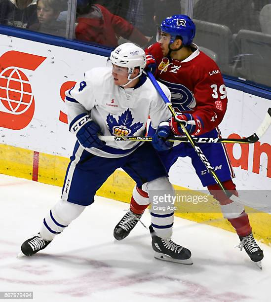 Adam Brooks of the Toronto Marlies battles with Jordan Boucher of the Laval Rocket during AHL game action on October 28 2017 at Ricoh Coliseum in...