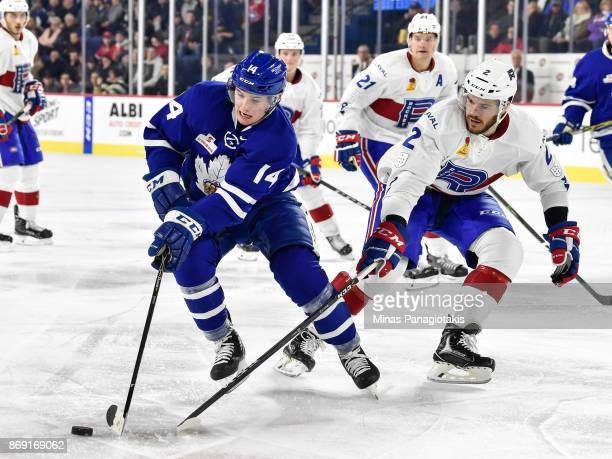Adam Brooks of the Toronto Marlies skates the puck against Eric Gelinas of the Laval Rocket during the AHL game at Place Bell on November 1 2017 in...