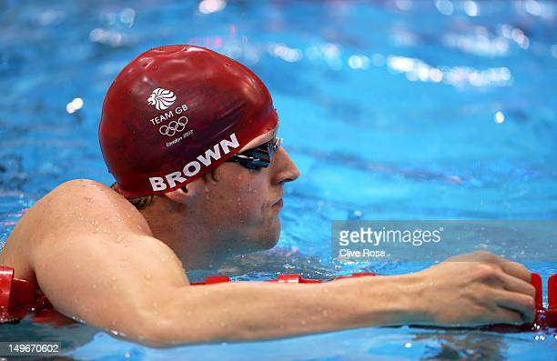 Adam Brown of Great Britain looks on after competing in the Men's 50m Freestyle heat 6 on Day 6 of the London 2012 Olympic Games at the Aquatics...