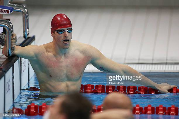Adam Brown of Great Britain reacts after Great Britain won the Men's 4x100 Medley Relay heat 1 on Day 7 of the London 2012 Olympic Games at the...