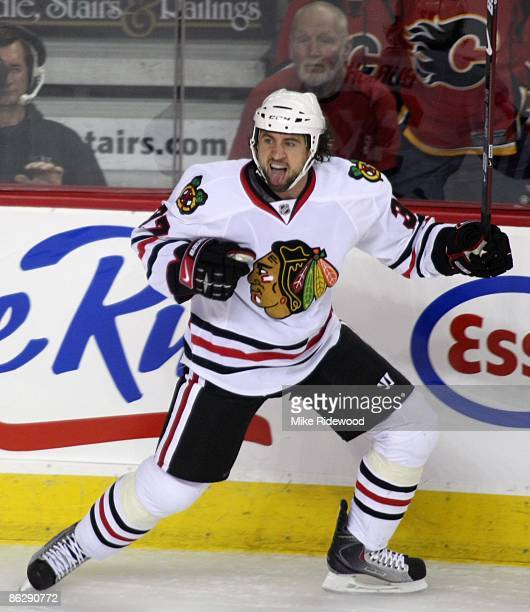 Adam Burish of the Chicago Blackhawks celebrates his goal against the Calgary Flames in Game Six of the Western Conference Quarterfinals of the 2009...