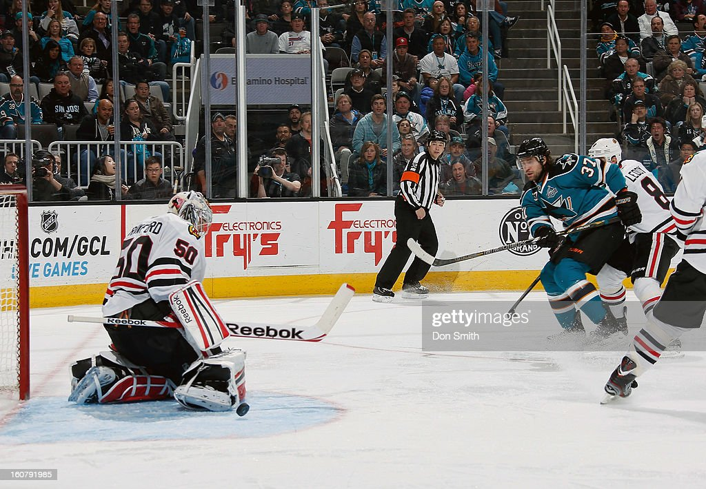 Adam Burish #7 of the San Jose Sharks attacks the net against Corey Crawford #50 of the Chicago Blackhawks during an NHL game on February 5, 2013 at HP Pavilion in San Jose, California.