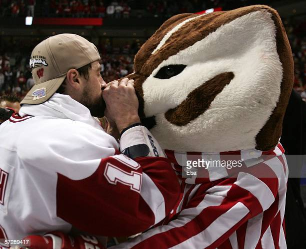 Adam Burish of the Wisconsin Badgers kisses Bucky the Badger during the NCAA Men's Frozen Four Championship game on April 82006 at the Bradley Center...