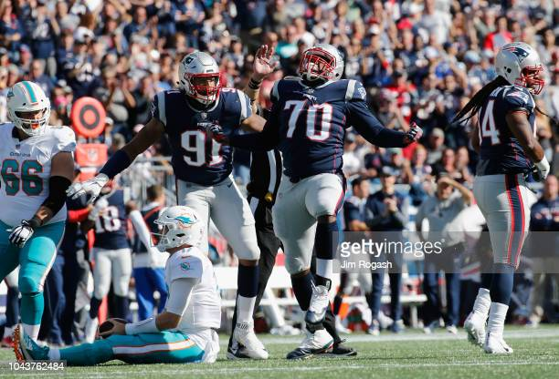 Adam Butler of the New England Patriots celebrates after sacking Ryan Tannehill of the Miami Dolphins during the second half at Gillette Stadium on...