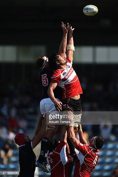 Adam Butterfield of Hong Kong and Shoji Ito of Japan compete for the ball in the lineout during the Asian Rugby Championship game between Japan and...