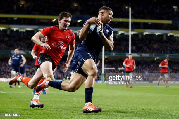 Adam Byrne of Leinster scores a try during the Champions Cup Quarter Final match between Leinster Rugby and Ulster Rugby at Aviva Stadium on March 30...