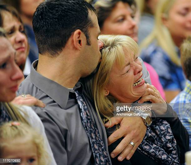 Adam Campbell embraces his mother Karen Foster after Superior Court Judge Jack Smith read the jury's guilty verdict of firstdegree murder in the...
