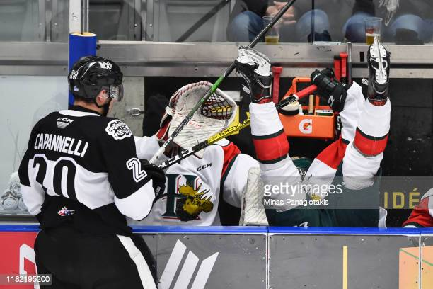 Adam Capannelli of the Blainville-Boisbriand Armada checks Said Abi-Faycal of the Halifax Mooseheads into the bench during the third period at Centre...