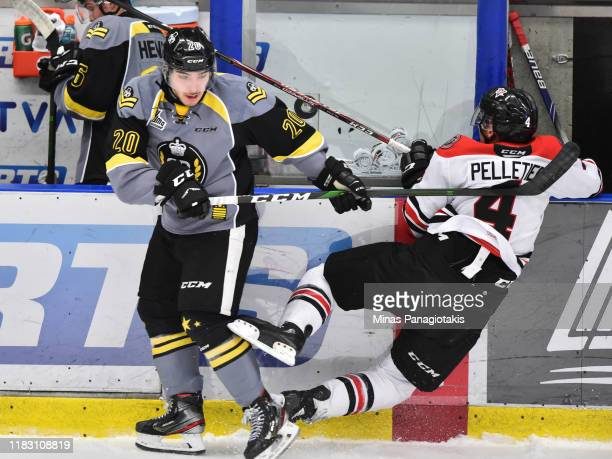 Adam Capannelli of the BlainvilleBoisbriand Armada drives Thomas Pelletier of the Drummondville Voltigeurs into the stanchion during the first period...