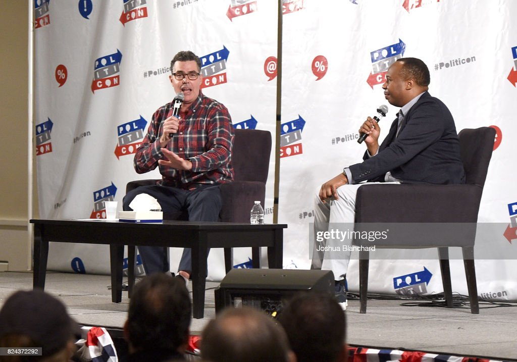 Adam Carolla (L) and Roy Wood Jr. at 'The Adam Carolla Show' panel during Politicon at Pasadena Convention Center on July 29, 2017 in Pasadena, California.