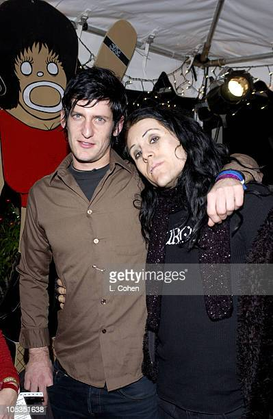 Adam Carson and Davey Havok of AFI during KROQ 1067 FM Almost Acoustic Christmas Day 1 Backstage at Universal Amphitheatre in Universal California...